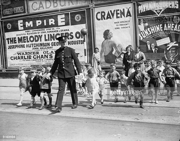 Schoolchildren crossing the road in Cardiff with Police Constable Williams