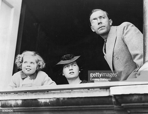 Prince Gustav Adolph , Princess Sibylla of Sweden and their daughter Margaretha on a balcony, watching a rehearsal for the trooping of the colour...