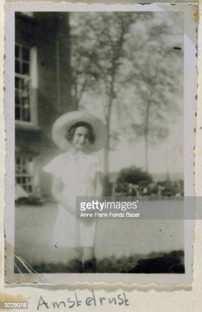 EXCLUSIVE Portrait of Anne Frank in front of a house wearing a sun hat taken from her photo album Amsterdam Holland