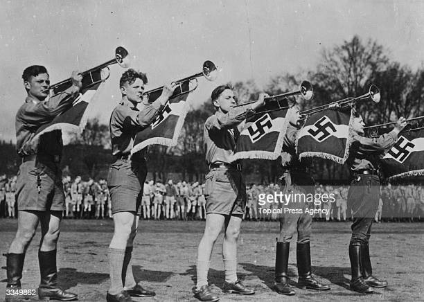 Trumpeters sounding a fanfare at a meeting of the Hitler Youth in Goslar Germany