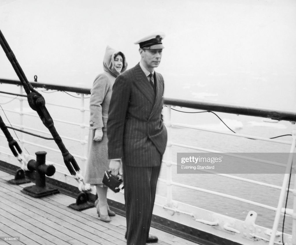 King George VI and Queen Elizabeth watching icebergs from the deck of the Empress of Australia during their Royal Canadian Tour.