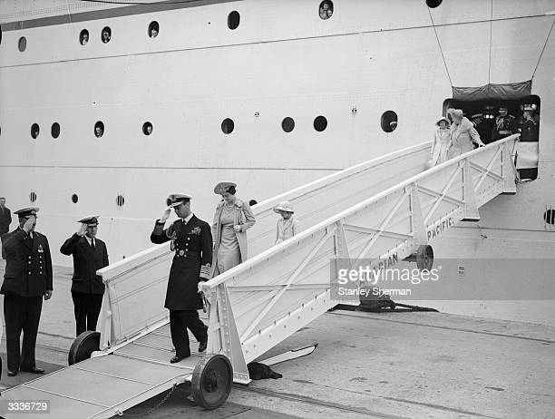 King George VI and the Queen Lady Elizabeth BowesLyon descending the gangway of the liner 'Empress of Britain' at Southampton