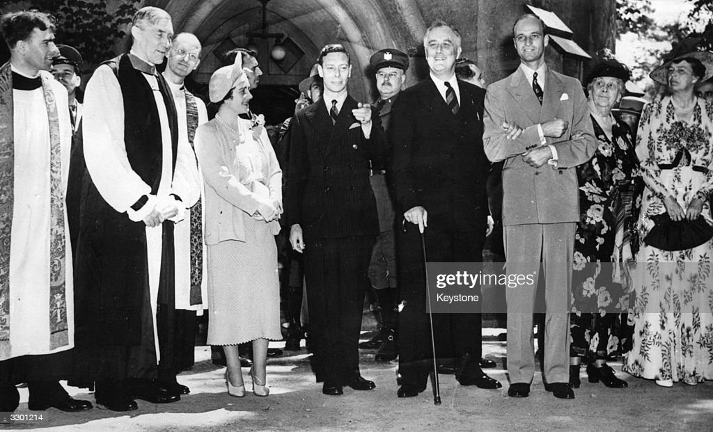 King George VI of Great Britain (1895 - 1952) and Queen Elizabeth (1900 - 2002, centre) outside St James Episcopal Church in New York with American president, Franklin Delano Roosevelt (1882 -1945) and his wife, social activist, author and lecturer, Eleanor Roosevelt (1884 - 1962) (right).