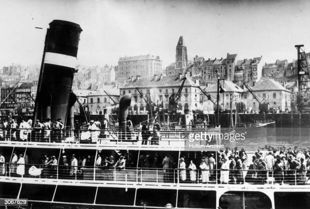 The liner 'France' arriving at Boulogne with two hundred and fifty German Jewish refugees from the liner 'Saint Louis' on board