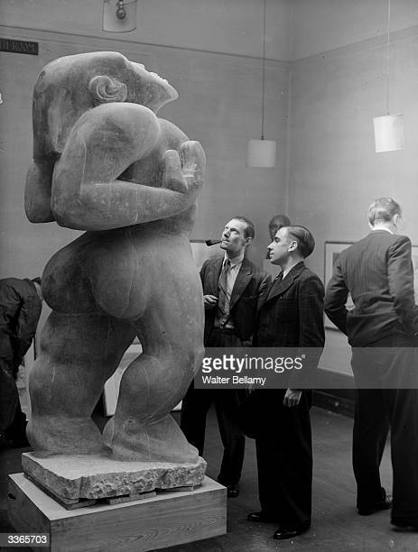 Visitors to a gallery study 'Adam' a piece by Americanborn British sculptor Jacob Epstein