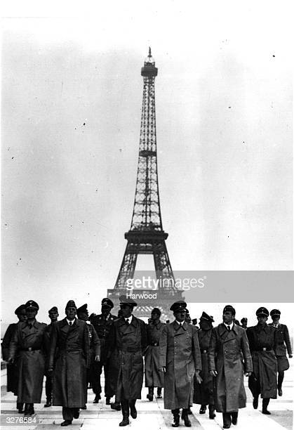 German dictator Adolf Hitler at the Eiffel Tower, Paris, with his generals during the German occupation of France. Also with him are sculptor Arno...
