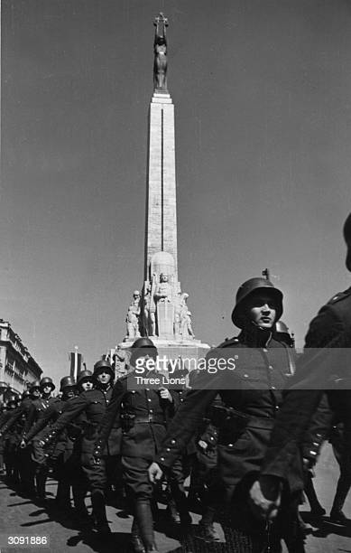 Latvian troops parade past the Statue of Liberty in the Latvian capital of Riga after the country's occupation by the Russians during World War II