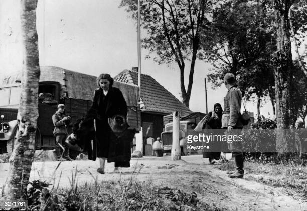 Nazi troops order Soviet womenfolk to leave their homes