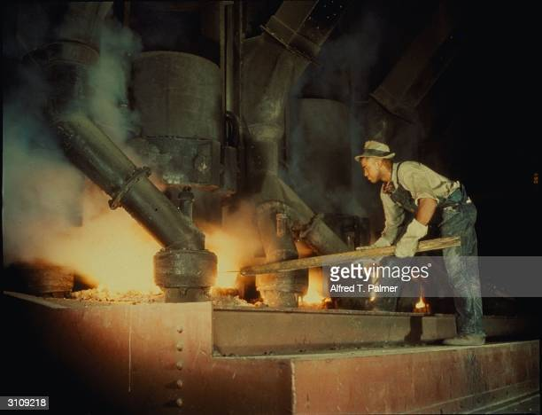 Workman at an electric phosphate smelting furnace in a Tennessee Valley Authority chemical plant near Muscle Shoals