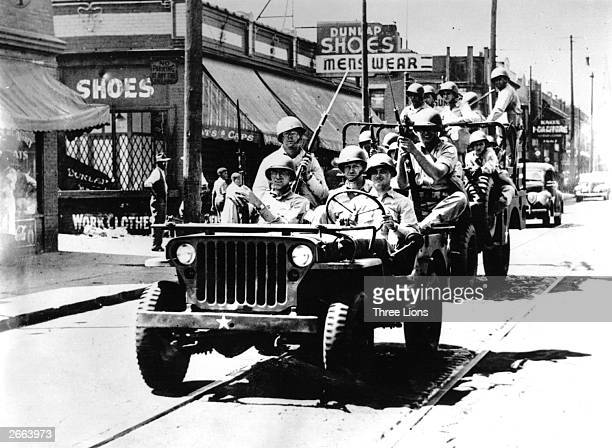 Federal troops patrol the streets of Detroit in a jeep after 29 people were killed in race riots