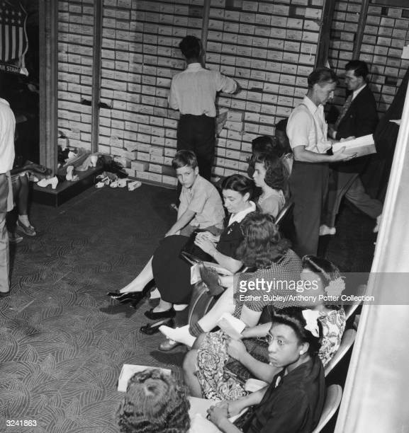 People wait in a shoe store on the last day on which war ration shoe coupon 17 may be used, Washington, DC, World War II.