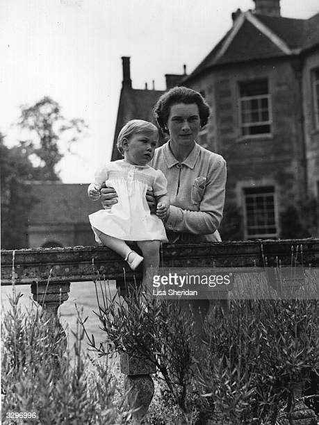 Prince William of Gloucester as a baby being held by his mother the Duchess at Barnwell Manor Northamptonshire
