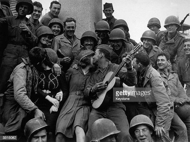 Happy crowd of American soldiers receive a warm welcome from the inhabitants of Cherbourg, after its liberation.
