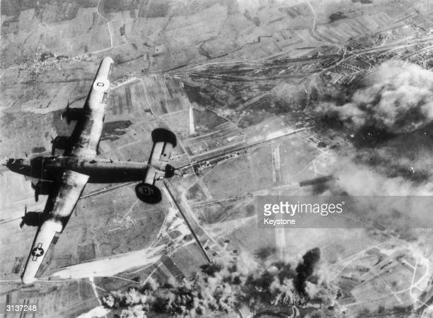 A Liberator bomber of the Eighth US Army Air Force returns to its home base after bombing a German airfield near St Dizier near the Marne River in...