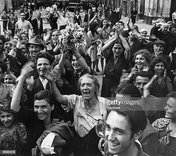 Crowds in Italy celebrate their liberation by the Allied forces towards the end of World War II.