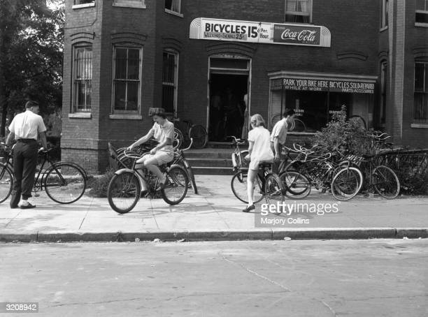 People gather at a bicycle rental shop on 22nd street in Washington D.C., World War II.