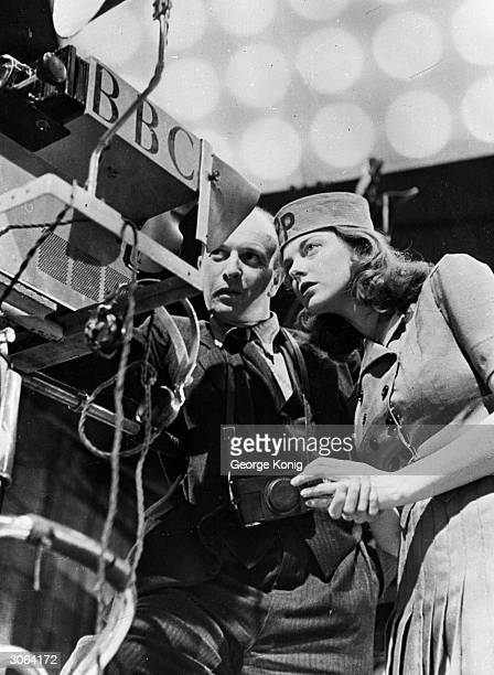 24yearold Paddy Bath new hostess of the television show Picture Page learns the workings of a TV camera from BBC cameraman O Eddy at Alexandra Palace...