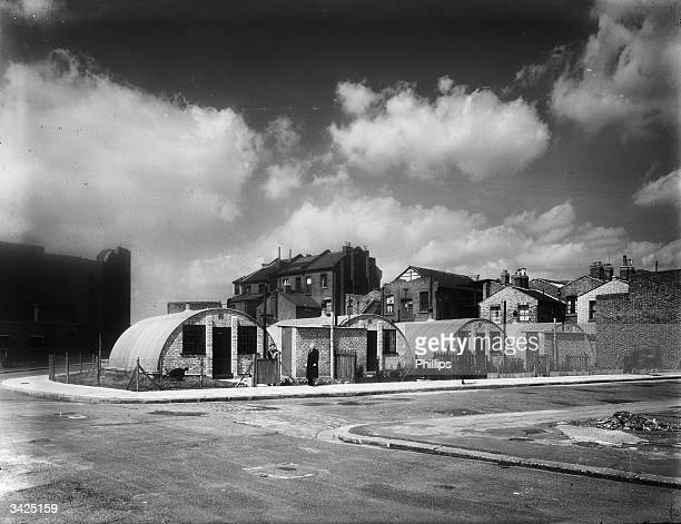 Nissen huts used as temporary homes in a bombdamaged area
