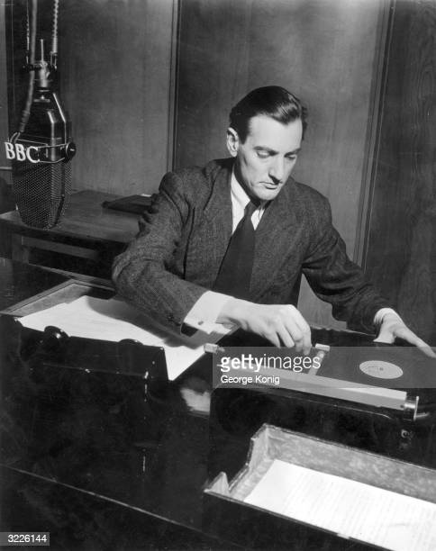 At a studio in Broadcasting House in London BBC radio announcer Roy Williams plays a record during an interval in the Light Programme
