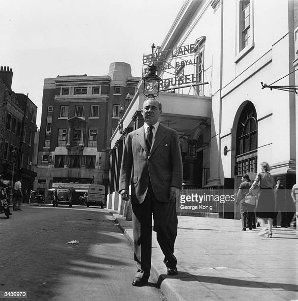 Composer and songwriter Richard Rodgers outside the Theatre Royal, Drury Lane, London. The theatre is showing 'Carousel', which he wrote with his...