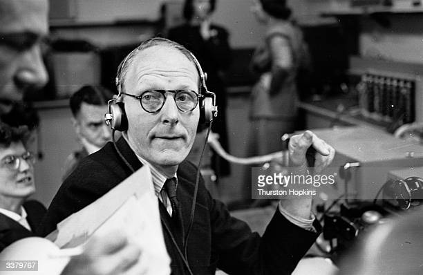S J de Lotbiniere head of television's outside broadcasting section coordinates all the movements of the BBC mobile units which will provide coverage...