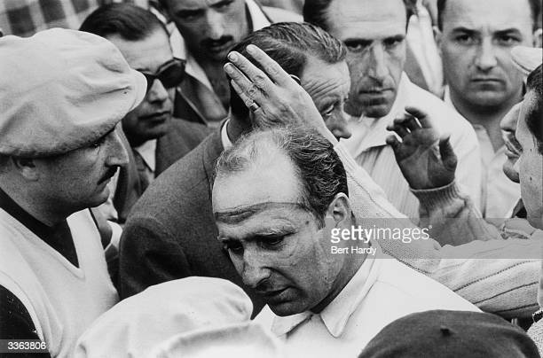 Argentinian motor racing legend Juan Manuel Fangio of the Mercedes Team at the scene of the Pierre Levegh disaster at Le Mans in which Levegh and 80...