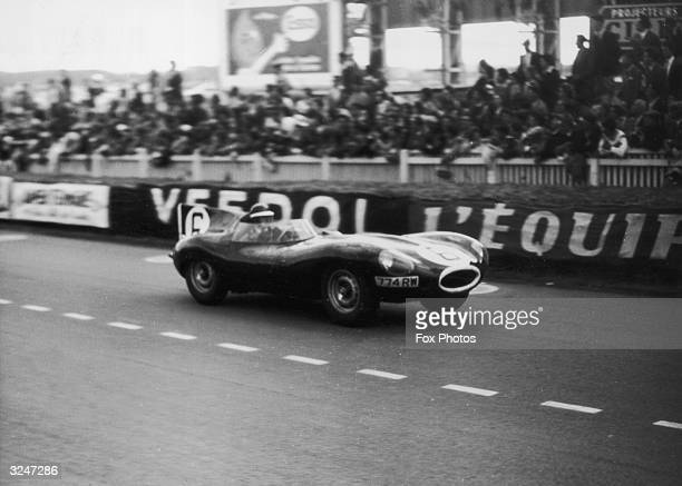Mike Hawthorn and Ivor Bueb drive a British Jaguar to victory in the Le Mans 24-hour endurance test, achieving a record speed of 107.06 miles per...