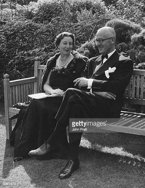 Operagoers Miss S Bourne and Mr F Dobson enjoy the evening sunshine in the gardens during an interval at the Glyndebourne Festival Sussex