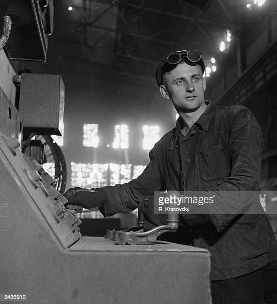 Russian steelworker Dmitri Galushko mans the control desk of an electrical furnace at the Dneprospetstal mills in Zaporozhye. He has recently been...