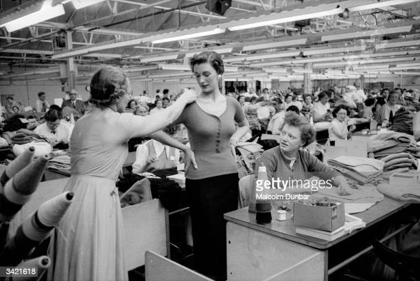 Workers in a Scottish cashmere factory adjust the measurements of a tightfitting top The woollens industry is important to Scotland and ranges from...