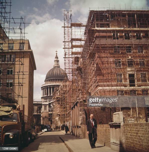 June 1956 view looking towards St Paul's Cathedral of various office buildings being constructed on land cleared following the destruction of...