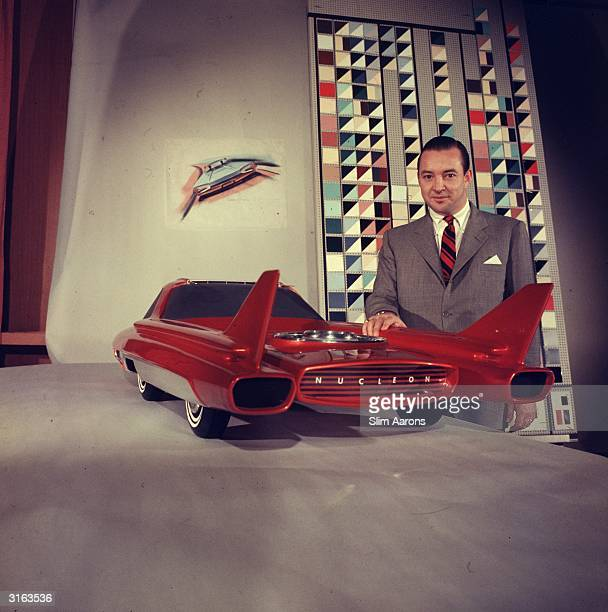 Car magnate William Ford with a model of Ford company's concept car the 'Nucleon'