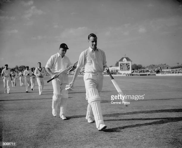 English cricketers Peter May and Colin Cowdrey leaving the field at Edgbaston Birmingham after a record partnership of 411 runs against the West...