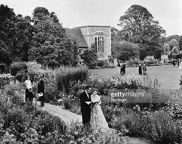 Opera fans discuss one of the performances during the annual Glyndebourne Opera Festival near Lewes in Sussex