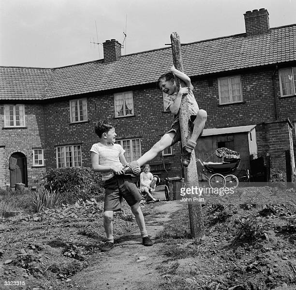 12 year old John Ryder and his friend Trevor Briscoe play in a back garden in the coal mining area of Amthorpe near Doncaster Surprisingly miner's...
