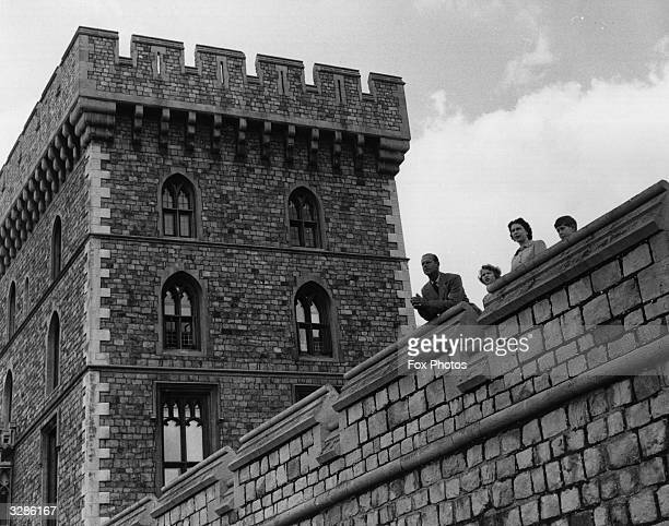 Queen Elizabeth II Duke of Edinburgh and family look over the East Terrace at Windsor Castle with the Queen's Tower in the background