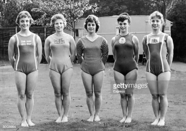 Fulllength portrait of the British Olympic women's gymnastic team Denise Godard Pat Perks Gwynedd Lingard Dorothy Summers and Margaret Neale wearing...