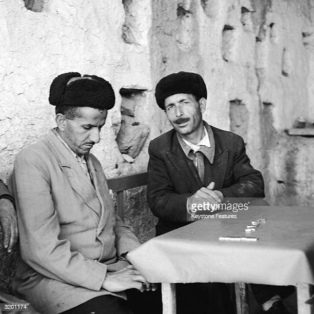 Two Kurdish men sit and talk in the Kurd held North of Iraq
