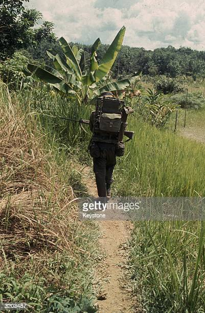 A radio man from the Durham Light Infantry on patrol in the jungles of Sarawak