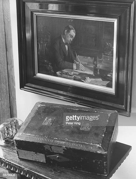 The despatch box of former prime minister and chancellor of the exchequer Sir Winston Churchill sits at his home Chartwell below a portrait of his...