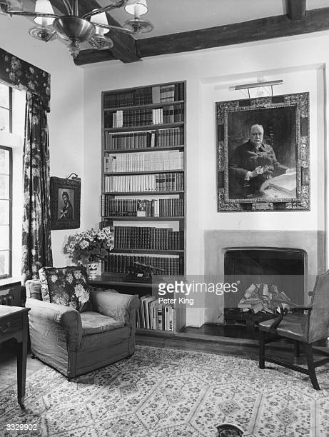 The library at Chartwell home of former British prime minister Sir Winston Churchill Over the fireplace is a picture of Sir Winston painted by Frank...