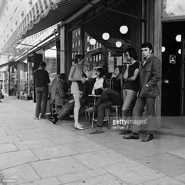 A waitress takes an order outside a pub in Chelsea London