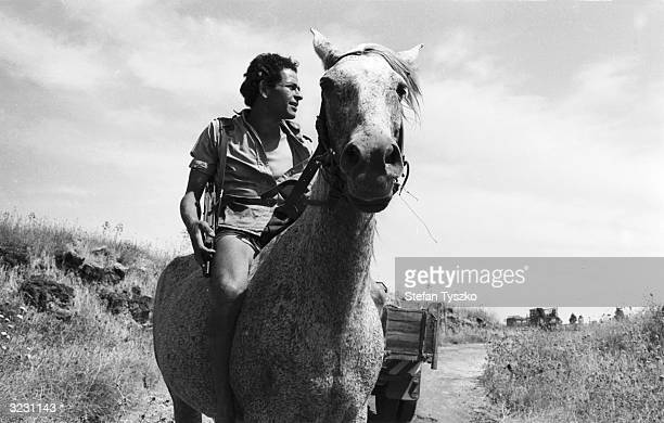 An armed Israeli agricultural worker close to the frontier with Syria during the Arab Israeli Six Day War