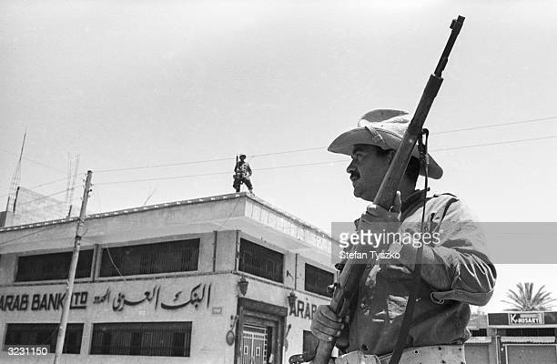Armed Israeli soldiers patrolling in Gaza while the Arab curfew is in effect during the Six Day War
