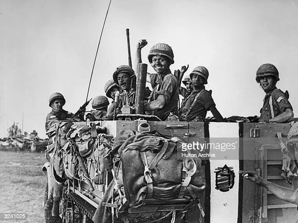 Israeli soldiers smile and raise their hands from the bed of a large army truck during the Six Day War Abu Agillah in the Gaza strip Middle East...