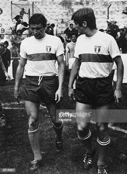 Italian strikers Luigi Riva and Gianni Rivera walk onto the pitch before their World Cup match against Israel in Mexico.