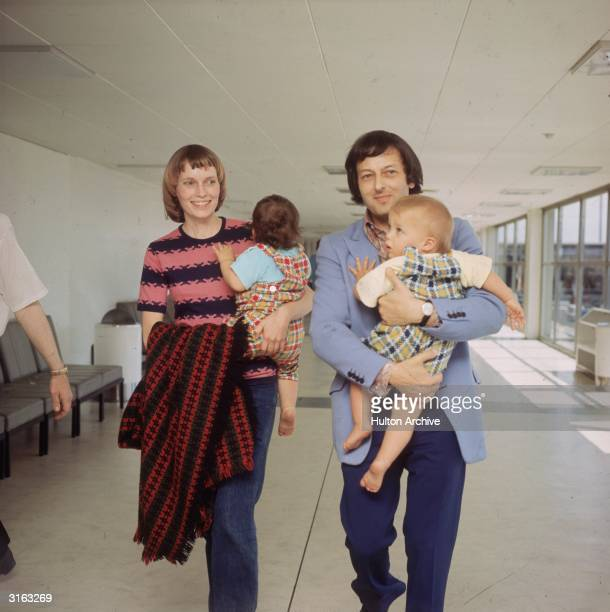 Actress Mia Farrow with her conductor husband Andre Previn and their twin sons at London Airport