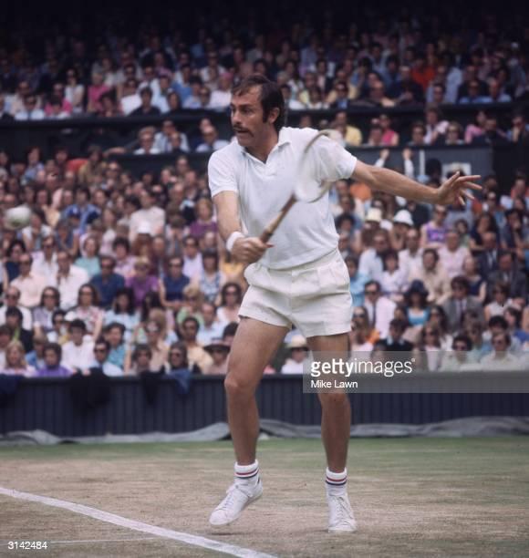 Australian tennis player John David Newcombe wins the Men's Singles Championships at Wimbledon for the third time