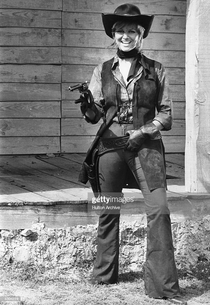 Claudia Cardinale gets ready for her role in a new Western film being shot in Spain. She is to star in 'Les Petroleuses' with Brigitte Bardot, playing leaders of two rival outlaw gangs arguing over a ranch where oil has been found.