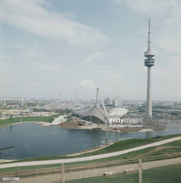 June 1972 of the Olympiaturm or Olympic Tower and the Munich Olympic Park with the Olympic Stadium Olympic Swim Hall and Olympiahalle all in the...